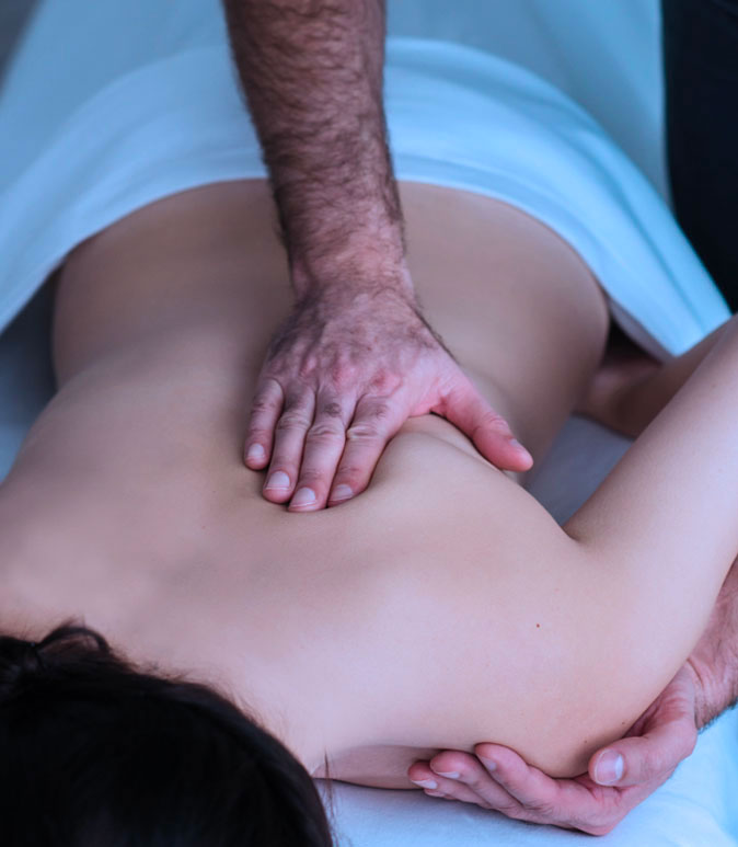A woman receiving massage therapy on her back